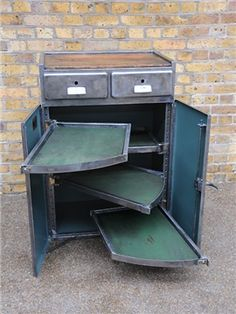 Vintage industrial cabinet. If you like this then check out my shop for one of a kind handmade art and decor items https://www.etsy.com/shop/SalehDesigns?ref=si_shop industrial chic vintage reclaimed up cycled repurposed game of thrones gears steampunk welded steel sculptures eclectic decor