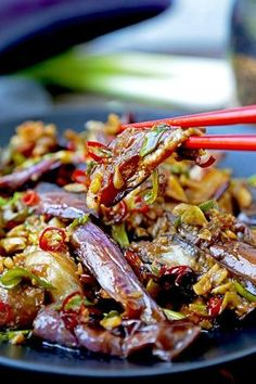 Chinese Eggplant With Garlic Sauce - This is a quick and easy dish that's sweet, tangy with a little heat. The eggplant pieces are so tender, they almost melt in your mouth. Ready in 15 minutes from start to finish. Chinese stir fry recipe, #vegetarianrecipes #eggplant #veganrecipes #stirfry #chinesefood #plantbased | pickledplum.com