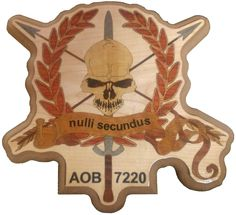 """Nulli Secundus Plaque  12"""" x 11""""  The """"Nulli Secundus"""" plaque is inlaid with natural and color dyed wood veneer and coated with thick, durable epoxy. This particular plaque was made for mounting in shadow boxes box could be made with an engraving area for personalization.  Contact me through Facebook at www.facebook.com/collectablewoods or email at bmwelch@collectablewoods.com."""