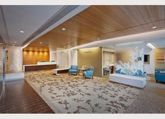 Ewing Cole design : Repeated floral design element gives this reception area cohesiveness.