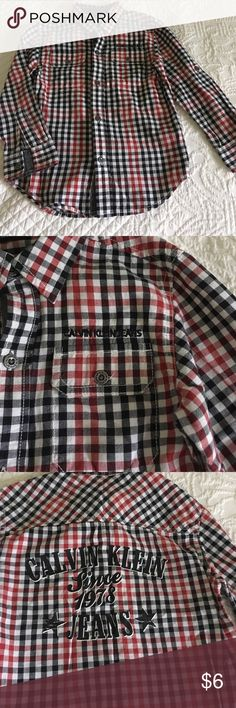 Calvin Klein Boy's Button-down Shirt This shirt  has long sleeves that can be rolled up and attached to a button on the sleeve. Sharp! Calvin Klein Shirts & Tops Button Down Shirts
