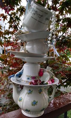 ******Taste of Wonderland******* Bring the magic to your Mad Hatter Tea Party with this amazingly intricate stacked teapot tower! This centerpiece is covered in whimsical accents, from top to bottom, and is made from several different teacups, saucers, and a gorgeous floral print teapot. This gorgeous centerpiece is about 16 in height, and be the center of attention at your Alice in Wonderland event! Use the centerpiece for a Mad Hatter Bridal Shower, Alice in Wonderland Baby Shower,...
