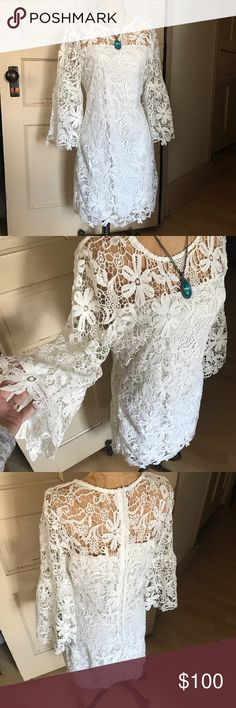 Mod Style Wedding Dress This dress is perfect if you're looking for a little vintage flair! It has fun bell sleeves, and crochet flower lace. Dress is lined! Bought this as a wedding option, but ended up using it for my bridal shower instead 💕 Bisou Bisou Dresses