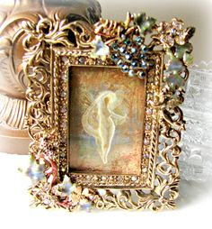 Kirks Folly Angel Vineyard Jeweled Frame, Gold Tone, Easel Back, 2 x 3 picture, Cherub, Faerie, Enamel and Rhinestones, Grapes and Leaves by SentimentalVintager on Etsy https://www.etsy.com/listing/466086550/kirks-folly-angel-vineyard-jeweled-frame