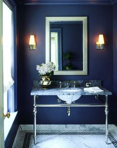Rich navy walls give this simple bath character. It pairs really well with Carara marble.