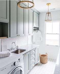 Painted Cabinets, Starburst Floor, Brass details. Laundry room bliss