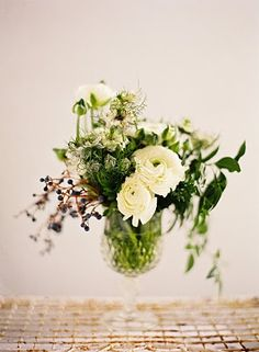 I love the elegance of this arrangement, and the loose, whimsical shape the berries and foliage give it.