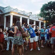 frat bro fraternity party darty day party college students pre-gaming guy shotgunning a beer