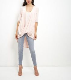 "Cameo Rose. Give skinny jeans a sophisticated lift with this shell pink wrap front top. Finish the look with perforated heels for a feminine day to night feel. - Wrap front design- V neckline- 1/2 sleeves- Dip hem- Casual fit that is true to size- Model is 5'8""/176cm and wears UK 10/EU 38/US 6"