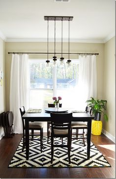 We're obsessed with this modern dining room. The plates on the wall are from HomeGoods as well as the yellow garden stool! Love this rug Dining Room Table Decor, Dining Room Design, Room Decor, Dining Rooms, Dining Area, Dining Room Inspiration, Home Decor Inspiration, Design Inspiration, Small Square Dining Table