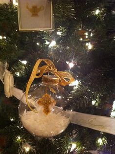 This original Chrismon ornament... I took a shatter proof ball (you can get from any craft store).  I added artificial snow in the bottom, then I took a cross out of felt added glue and glitter, attached a gold cord to hang from the top and used the cap to hold it in place.  Since the Chrismon ornaments are gold and white and the cap was silver,  I glued a shiney gold velvet ribbon around the cap and added a matching bow to the top.  I think they turned out so pretty!