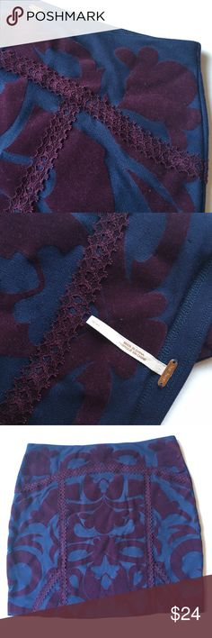 """Free People Mini Skirt  Velvet & Lace Details NWOT Dark blue knit with velvety purple print   Stretch material and lace trim. Cooler is reflected in first two photos. Last photo was lightened to show print. 14"""" waist, 14.5"""" length. New without tags. Never worn Free People Skirts Mini"""