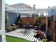 patio-pergola-landscaping-ideas-backyard-garden...concrete or stone boards...similar to deck boards...close arrangement at table, circulation areas...less dense...mor loosely arranged at perimeter...could be concrete pavers..or stone pavers, or wood board (raised)