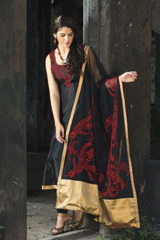 Silk churidar kurta along with net dupatta in resham work.