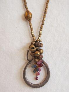 necklace with open oval and bead dangles.