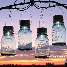 Mason jar lanterns! Attach solar lights to the top and hang outside :)