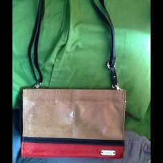 The Sak crossbody shoulder bag The Sak crossbody. Light brown, red leather trim. Has outside iPhone slip. Small sized. The Sak Bags Shoulder Bags