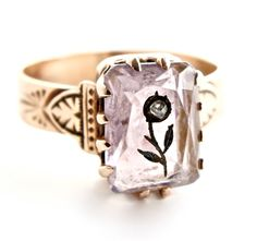 I'm in love.  Swoon.   Antique 10k Rose Gold Victorian Ring -  Etched Flower Pastel Amethyst Purple Stone Fine Jewelry / Rose of Sharon. $350.00, via Etsy.