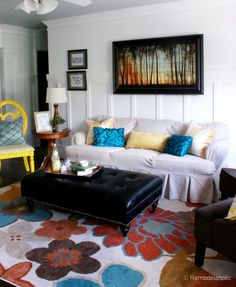 love the print on the wall - want to try it with watercolor and acrylics  Living Room Remodel with yellow accents wood floors and built-in bookcases and columns with arches-14