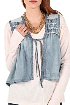 Add a pop of boho-chicness to your next basic top and jeans combination. Rendered with a smock and weave inset combined with a tribal-inspired back detail.  Chambray Vest by Miss Me. Clothing - Jackets Coats & Blazers - Vests New Hampshire