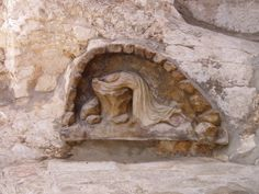 Relief carving of Jesus praying in the Garden of Gethsemane, Mount of Olives, Jerusalem, Israel...