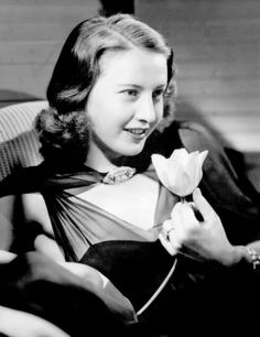 Barbara Stanwyck, love the tulip in her hand