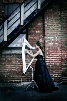 M'Michele (Harpist).  I'm sure she plays beautifully, but what interests me most is the stand - where can I get one of those for my lap harp?