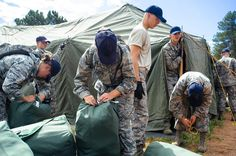 Cadets set up tents after marching to Jacks Valley as part of Basic Cadet Training at the United States Air Force Academy on Sunday, July 24, 2016.  Photo by @ryanjonesphotos, The Gazette. (Full gallery through link in bio)