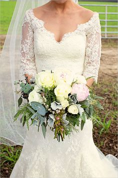 pastel winter wedding bouquet in long sleeve lace wedding gown. http://www.weddingchicks.com/2014/03/16/georgia-classic-barn-wedding/