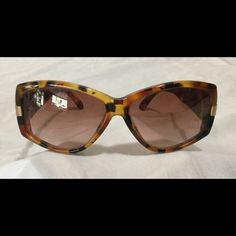 Valentino Tortoise Shell Gradient Sunglasses Valentino sunglasses. marked V603,  145 135, gradient lenses, they are brown color with a hint of rose size small, they are definitely for a small head, lens are decent couple lite scratches, no case Valentino Accessories Sunglasses