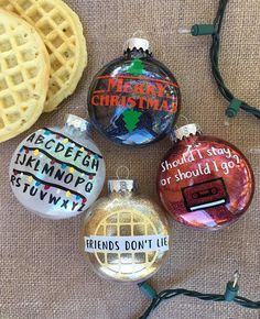 Its Christmas time in Hawkins, Indiana! Stranger Things *have* happened These beautiful ornaments will make your tree look like it belongs alongside The Upside Down These are glittered on the *inside* This listing is for either one full set of ornaments, or one single ornament ~ you are welcome to add more than one ornament to your cart. Shipping is the same as long as you stay at 5 or less ~ please message me if you would like a larger quantity! Save $5 by ordering a full-set...