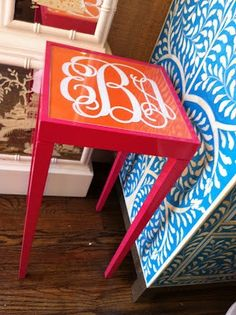 monogram table--an easy DIY with a cheap table and a vinyl monogram. Use Lilly paper under the glass!