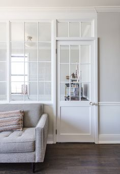 A hybrid window wall that is part opaque partition and part interior window keeps the space brightly lit! Thinking for random wall and window between dining room and Utility Interior Windows, Interior Walls, Interior Design, Home Living Room, Living Room Designs, Superior Room, Appartement Design, Window Wall, Room Partition Wall