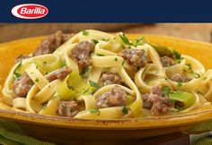 As sausage pasta recipes go, this creamy fettuccine recipe gets top marks. Try this Italian sausage fettuccine recipe with white wine sauce and leeks. Barilla Recipes, Fettuccine Recipes, Sausage Pasta Recipes, Pork Recipes, Wine Recipes, Cooking Recipes, Yummy Recipes, Healthy Recipes, Vegetarian Food