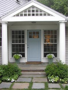 Charming door color with the gray exterior from House of Turquoise