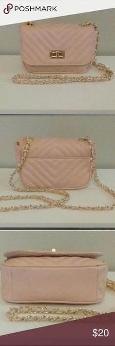 ALDO Blush Pink, Small Crossbody Bag Like new condition, no scratches, no stains, no flaws. Quilted style, blush pink small crossbody. Gold link chain wrapped around the strap. Gold turn lock closure. Middle zip pocket and a back wall zip pocket. *Will add measurements soon* Aldo Bags