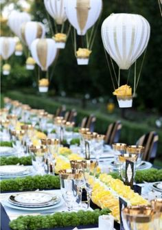 Those hot air balloons are so cute! Garden party tablescape with yellow roses, greens, and hot air balloon decors weddingdecor tablescapes gardenparty gardenpartywedding yellowwedding garden Romantic Wedding Centerpieces, Wedding Decorations, Table Decorations, Whimsical Wedding, Centerpiece Ideas, Hanging Centerpiece, Balloon Centerpieces Wedding, Outdoor Decorations, Yellow Centerpieces