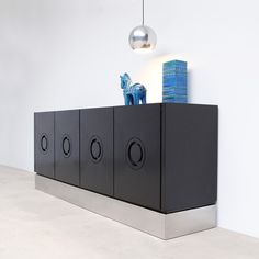 Belgium  1970's  Stunning black-lacquered ebonized solid wood credenza with graphically styled panel-doors.