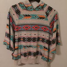 Aztec boho hoodie Forever 21 Aztec patterned hoodie. This has poncho style sleeves that hit around the forearm, a small pocket on the front that opens from both ends and a hood. It feels like cotton t-shirt fabric, base is heather gray, fit is loose and boho. No trades. Offers welcome. Forever 21 Tops