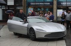 Spectre stunt driver Mark Higgins with a James Bond Aston Martin DB10 in Cardiff city centre which is being toured around the UK