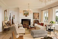 An English dog painting is set over the living room fireplace in Rob Lowe's Santa Barbara home, designed by David Phoenix, while a photograph by Lyndie Benson is above the Dutch secretary. | archdigest.com