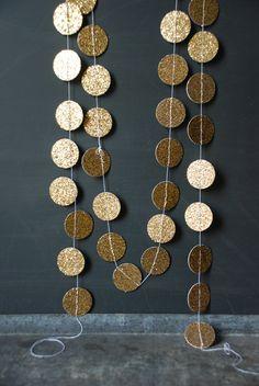 DIY Glitter Garland - Cut circles from glitter paper & run through the sewing machine.