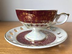 Japanese Footed Tea Cup and Saucer Red and White Lustreware