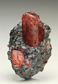 Rhodonite measuring to 1.4cm in the characteristic granular crystalline metallic Galena, from the North Mine, Broken Hill, Australia.