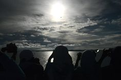 Passengers gather to watch the total solar eclipse onboard the Indonesian cruise ship KM Kelud near the island of Belitung in Indonesia on March 9, 2016. A total solar eclipse swept across the country, witnessed by hoardes of sky gazers and marked by parties, colourful tribal rituals and Muslim prayers.  / AFP / GOH CHAI HIN        (Photo credit should read GOH CHAI HIN/AFP/Getty Images)