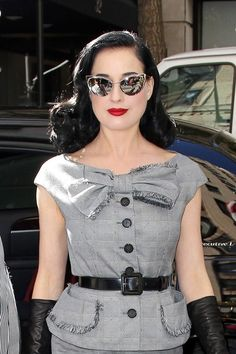 Dita - bow, belt, gloves, glasses.... Gorgeous.