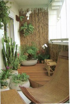 Transform your balcony into a mini garden. You can do this with help from an array of potted plants, wooden chairs and bamboo walls. Pick out various tropical plants, flowers and cacti to complete the look.
