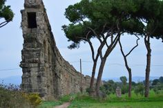 """A shot that gives an idea of the scale of the Claudian aqueduct, which stretches almost a mile into the distance. About ten miles beyond are the mountains from which the spring that fed the aqueduct came."""