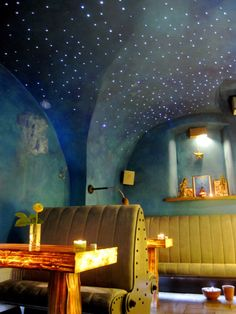 This looks like it could be a diner. Lovely blue walls and ceiling with built-in stars. The whole thing looks painted.