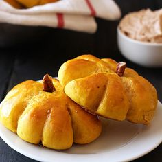 Pumpkin Bread Rolls with Cinnamon Butter are slightly sweet and totally festive with their easy and adorable pumpkin shapes. Everyone LOVES these!